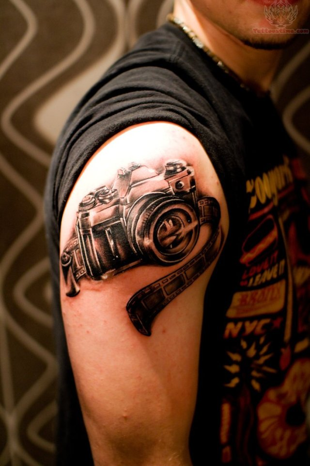 Most Beautiful Black Color Ink Camera & Film Strip Tattoo On Shoulder For Boys