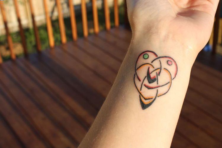 Most Elegant Motherhood Heart Shaped Knot Wrist Tattoo