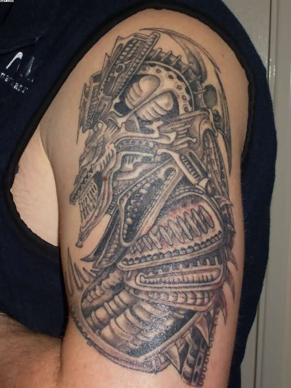 Nice Grey Color Ink Biomechanical Alien Tattoo Design For Boys