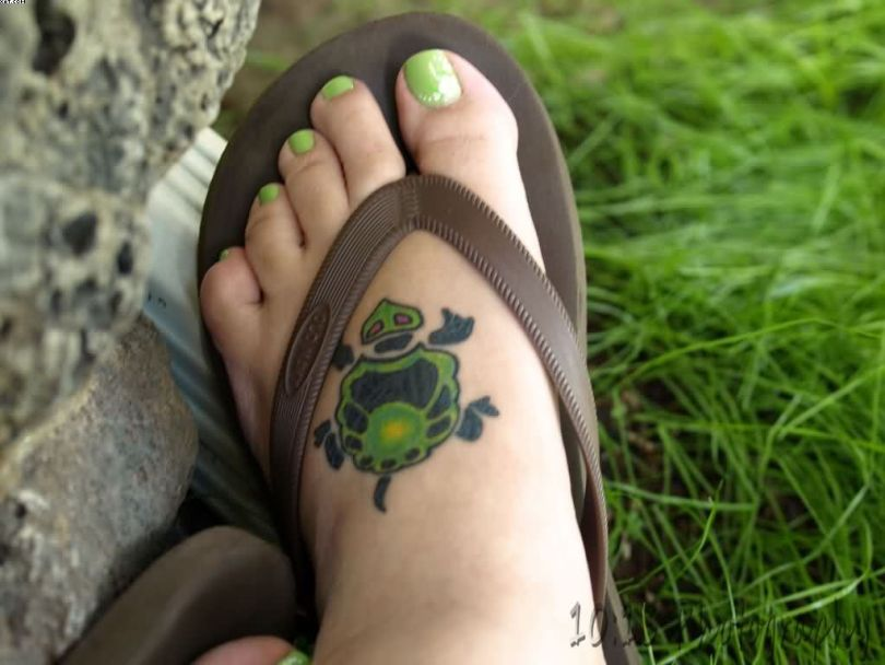 Nice Women Tattoo Of Turtle On Foot