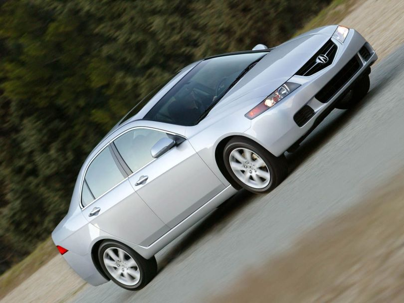 On the road of silver beautiful Acura TSX car