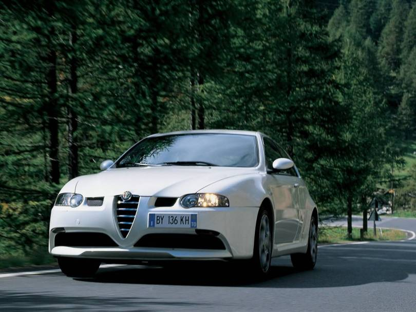 On the road view of beautiful White colour Alfa Romeo 147 GTA Car