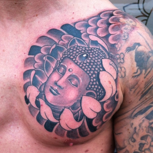 Out Standing Black And Red Color Ink Buddha Head Tattoo On Chest For Boys