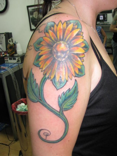 Out Standing Yellow Green And Black Color Ink Daisy Flower Tattoo On Shoulder For Girls