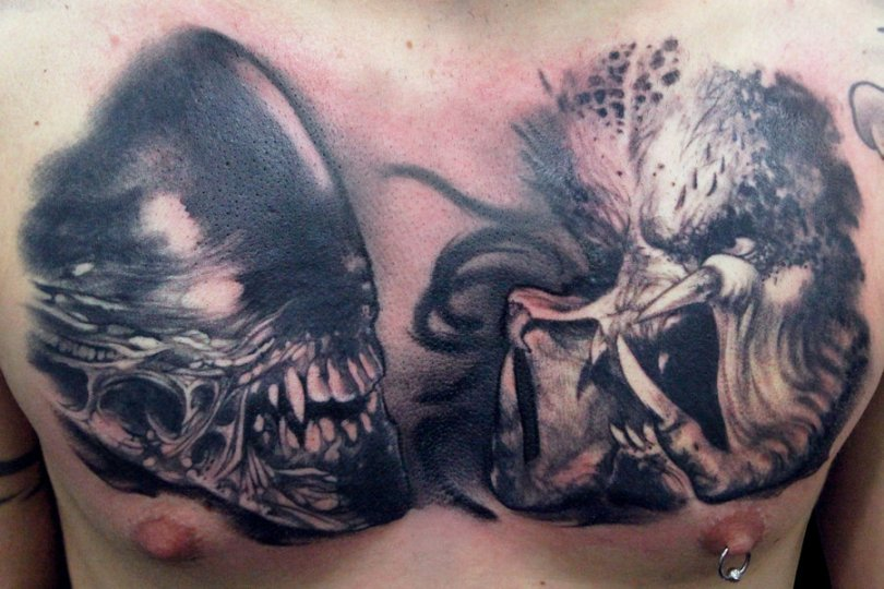 Passionate Black And Red Color Ink Angry Alien Skull Face Tattoo On Chest For Boys