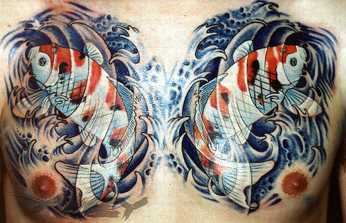 Passionate Black Blur And Red Color Ink Asian Fish Tattoo Design On Chest For Boys