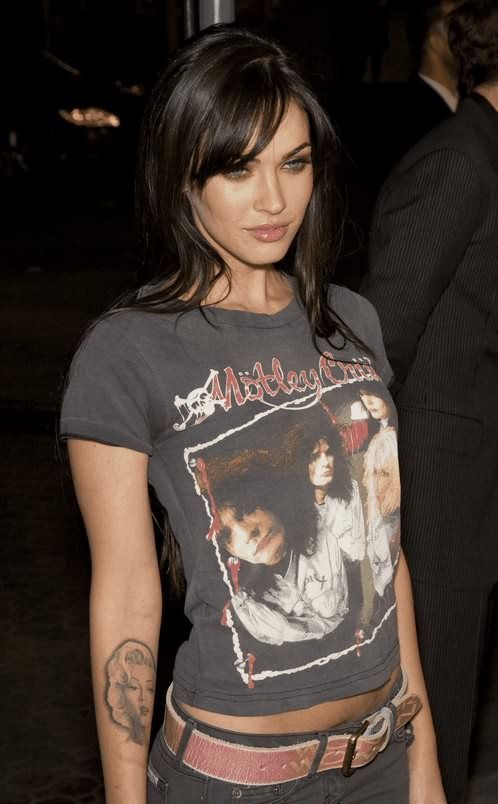 Passionate Black Color Ink Celebrity Face Tattoo On Arm For Girls