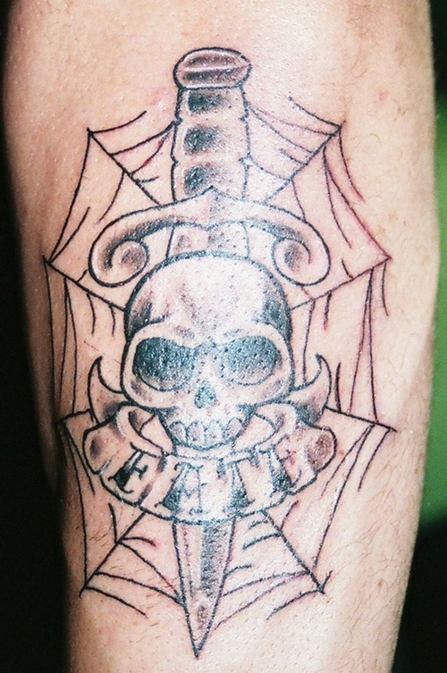 Perfect Black Color Ink Skull Dagger Tattoo Design For Boys