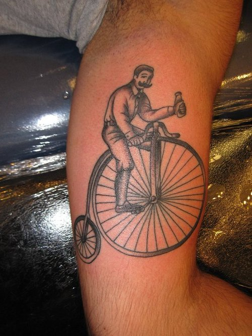 Realistic Black Color Ink Bicycle Tattoo On Muscles For Boys