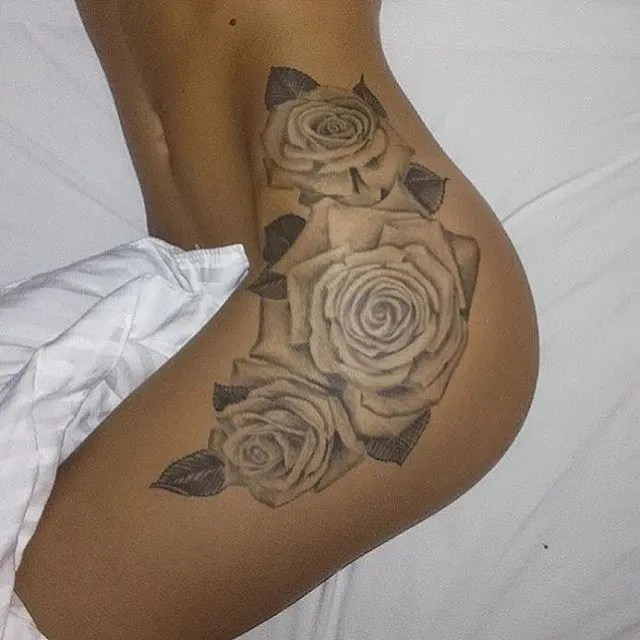Rose Tattoo On Leg In Black Ink