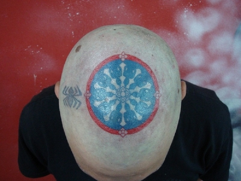 Sensation Blue Black And Red Color Ink Symbol Of The Land Of Buddhist Tattoo On Head For man