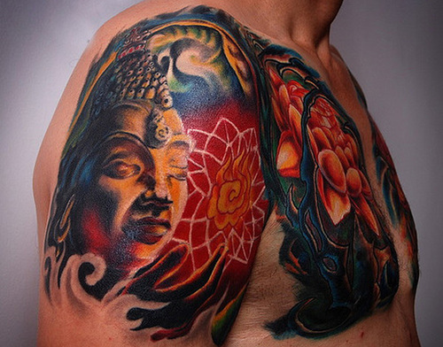 Sensation Blue Green Black And Red Color Ink Buddha Head Tattoo On Shoulder For Boys