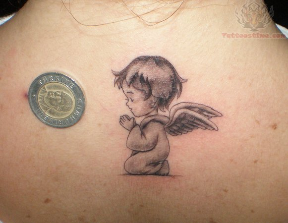 Stunning Black Color Ink Baby Angel Tattoo On Back Body For Girls