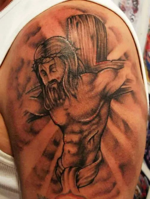 Stunning Red And Black Color Ink Jesus On Cross Tattoo Design For Boys