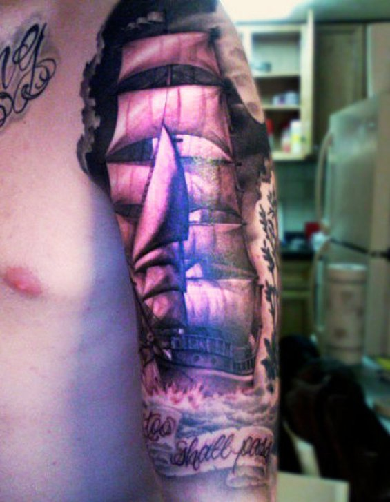 Stunning Red Blue And Black Color Ink Pirate Ship Tattoo For Biceps For Boys