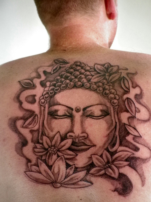 Superb Black And Red Color Ink Buddha Head & Flowers Tattoo On Upper Back For Man