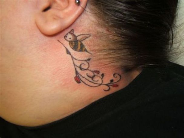 Superb Black And Yellow Color Ink Elegant Back Ear Bee Tattoo For Girls