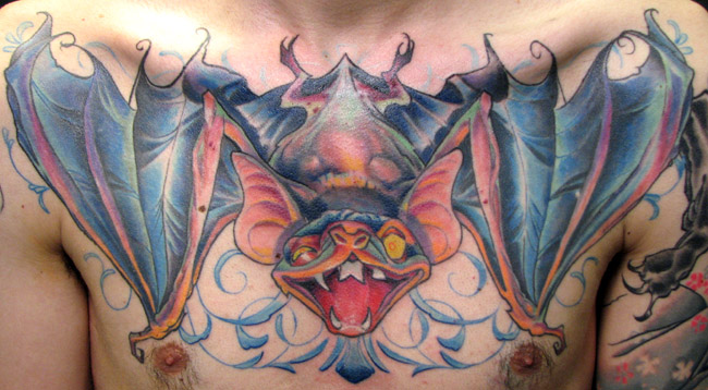 Superb Blue Yellow Black And Red Color Ink Big Bat Tattoo For Chest For Boys