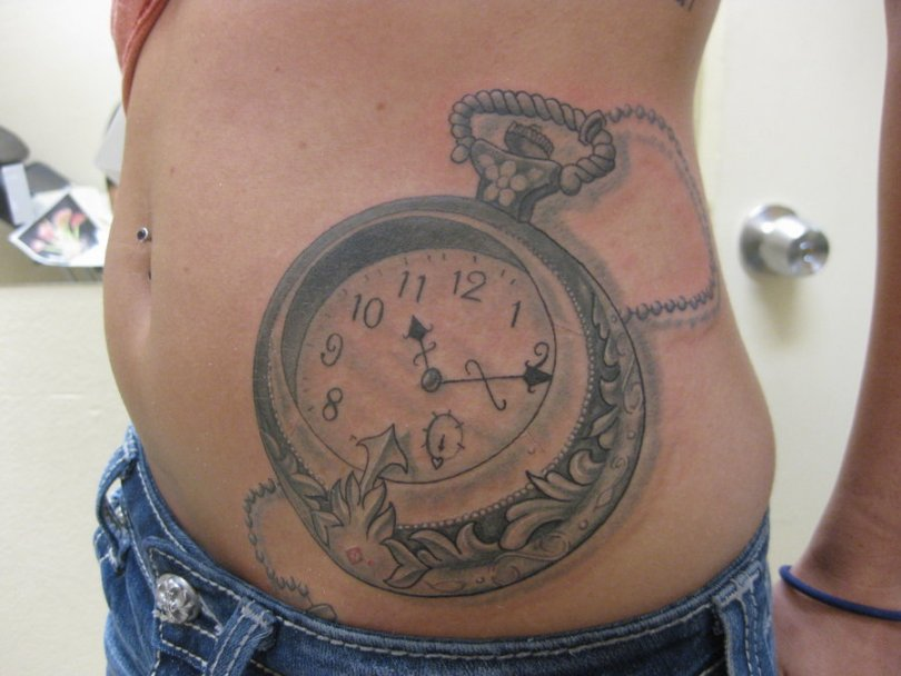 Sweet Black Color Ink Clock Tattoo On Waist For Boys