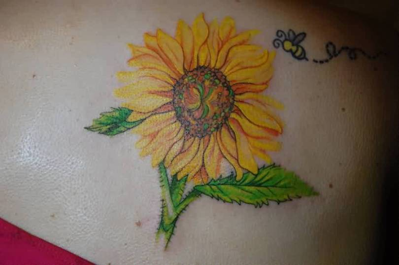 Sweet Green And Yellow Color Ink Bee Flying On Sunflower Tattoo Design On Shoulder Back For Girls