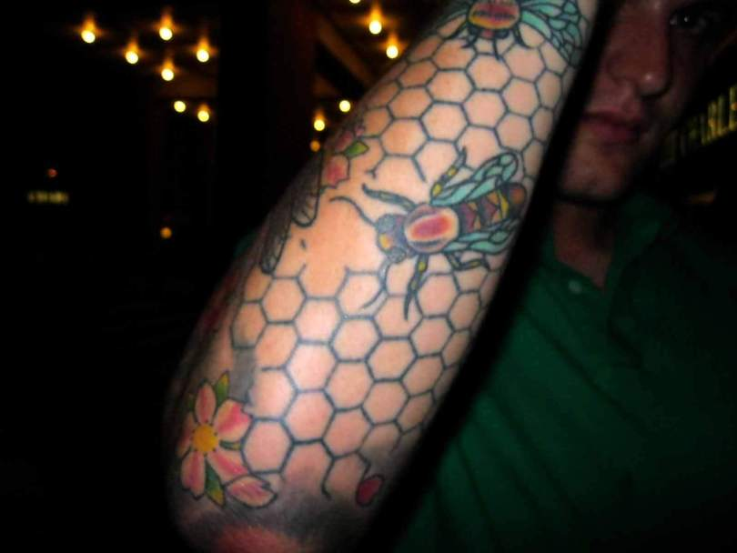Terrific Black Blue And Red Color Ink Bee Tattoo On Guy's Forearm For Boys