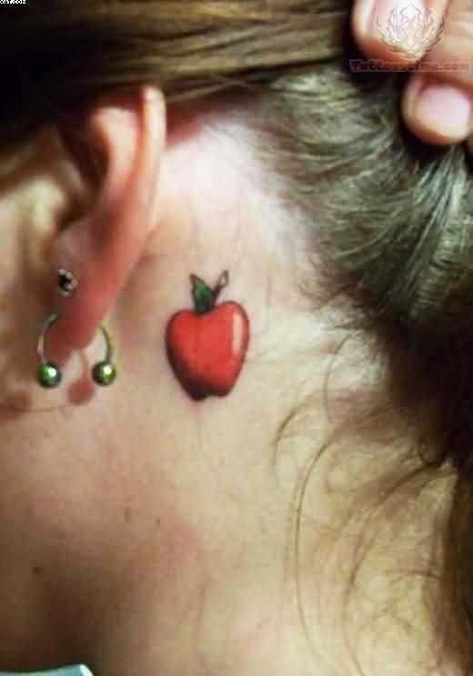 Traditional Green And Red Color Ink Apple Tattoo Behind Girl Ear For Girls