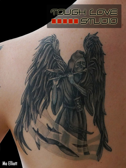 Ultimate Black Color Ink Winged Death Tattoo On Back For Girls