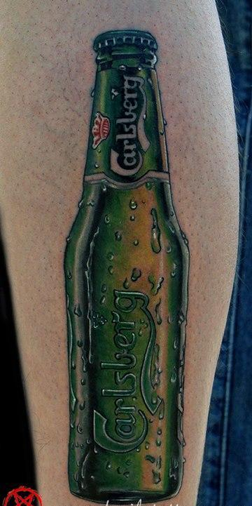 Ultimate Green And Red Color Ink Carlsberg Beer Bottle Tattoo On Leg For Girls
