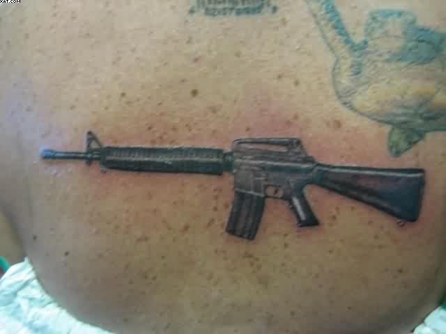 Unique Black Color Ink Army Gun Tattoo On Hip For Girls