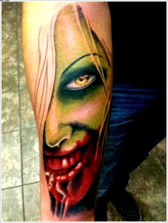 Very Bloody Zombie Chick Tattoo On Arm