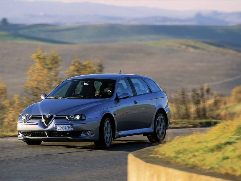 Very beautiful silver colour Alfa Romeo 156 GTA Car on the road