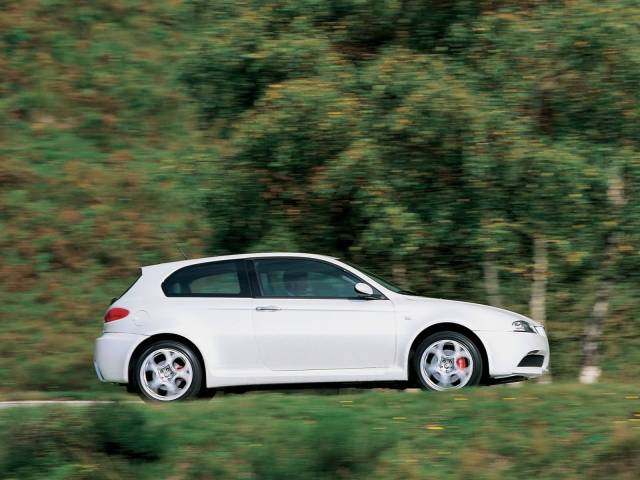 Very fast awesome White colour Alfa Romeo 147 GTA Car on the road