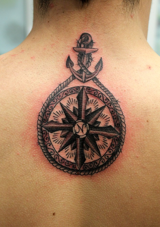 Weird Black And Red Color Ink Rope Anchor & Compass Tattoo On Upper Back For Boys