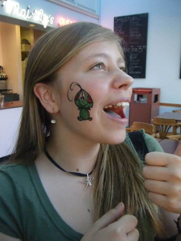 Weird Green And Red Color Ink Alien Tattoo On Face For Boys