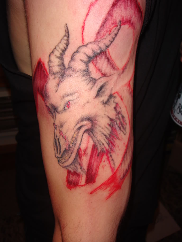 Weird Red And Black Color Ink Capricorn Tattoo For Biceps For Boys