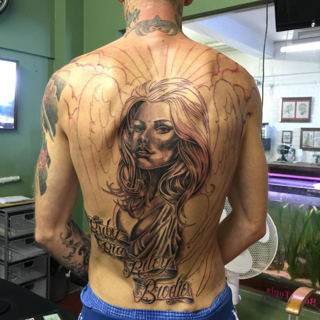 awesome back tattoo with black ink for man and woman