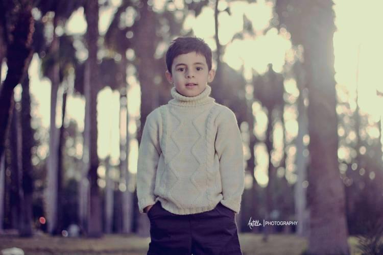 beautiful child among trees Full HD Wallpaper