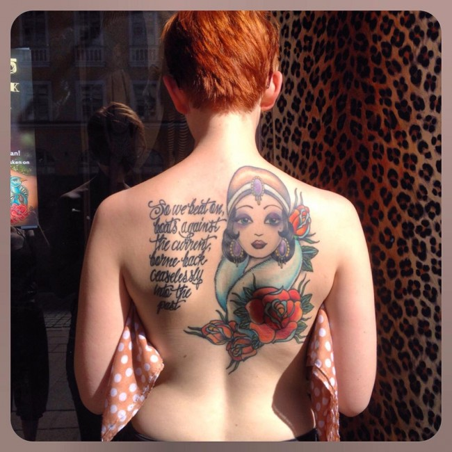 most dashing back tattoo with colorful ink for man and woman