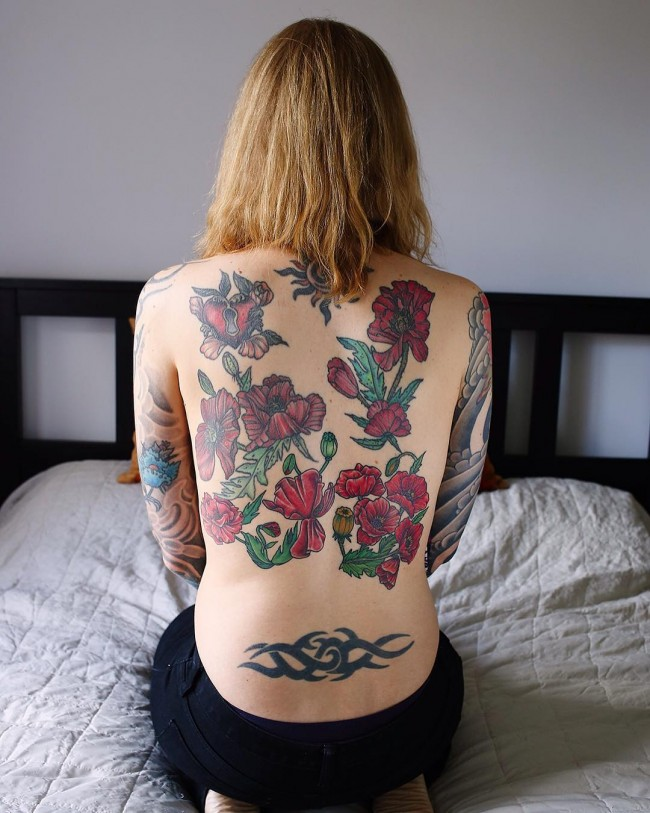 most tremendous back tattoo with colorful ink for man and woman