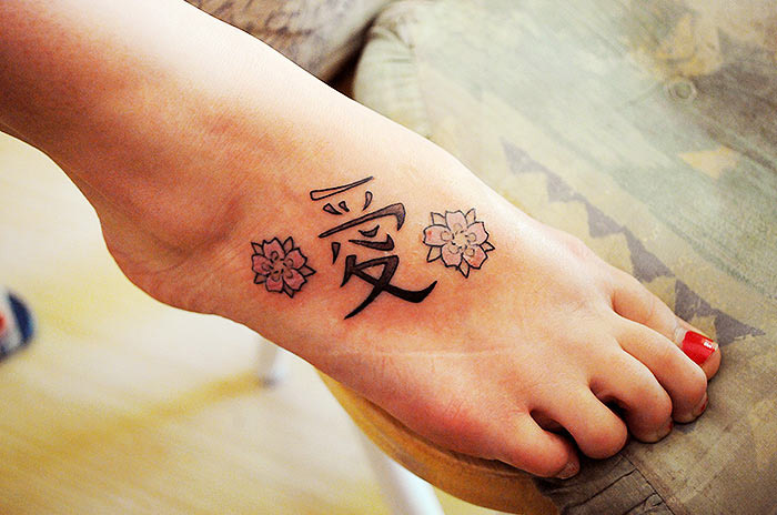 Adorable Chinese Love Tattoo On Foot For Girls