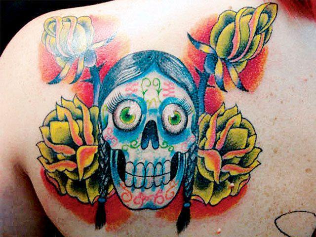 Adorable Dia De Los Muertos Skull Tattoo On Back Shoulder For Girls