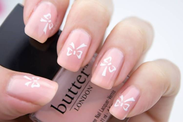 Amazing Pink Color Nail Paint With Ribbon And Almond Shaped Acrylic Nail Art