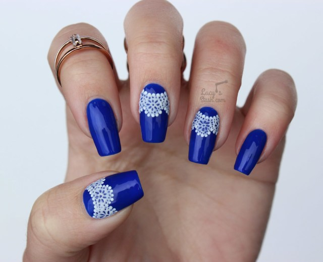Awesome Blue Nail Art With White Color Design