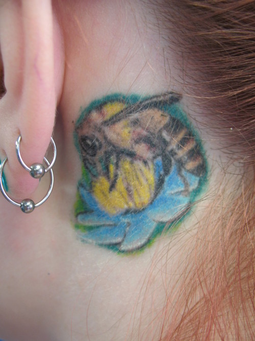 Brilliant Bee With Flower Tattoo Behind Ear For Girls