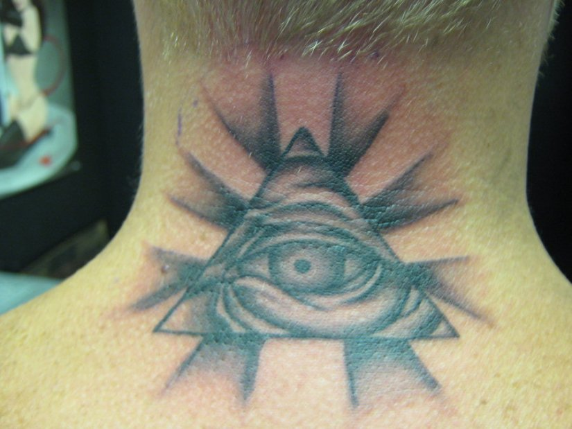 Charming Eye Tattoo On Back Neck For Boys