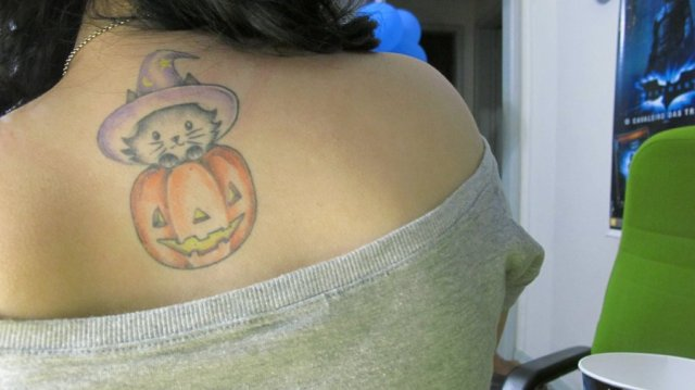Charming Halloween Cat Tattoo On Upper Back For Girls