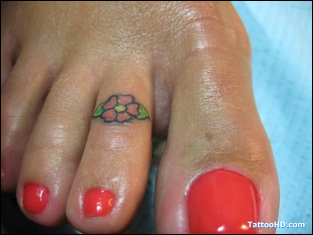 Charming Hibiscus Flower Tattoo Design On Toe For Girls