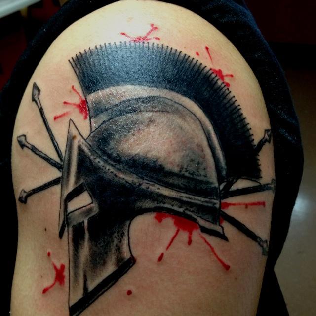 Crazy Blood And Spartan Helmet Tattoos On Shoulder For Boys