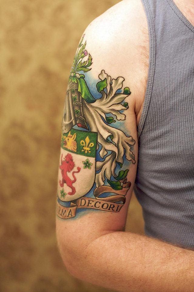 Crazy Family Crest Tattoo Design For Boys
