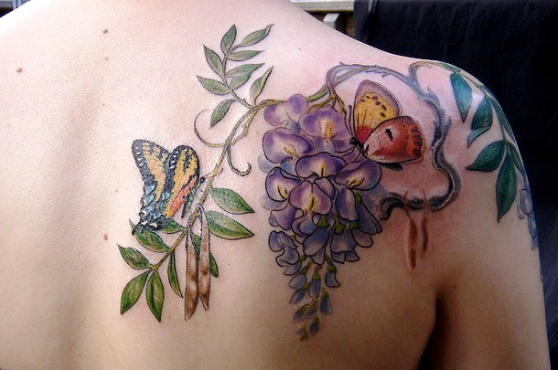 Creative Butterfly Lily Flower Tattoo On Back Of Shoulder For Boys